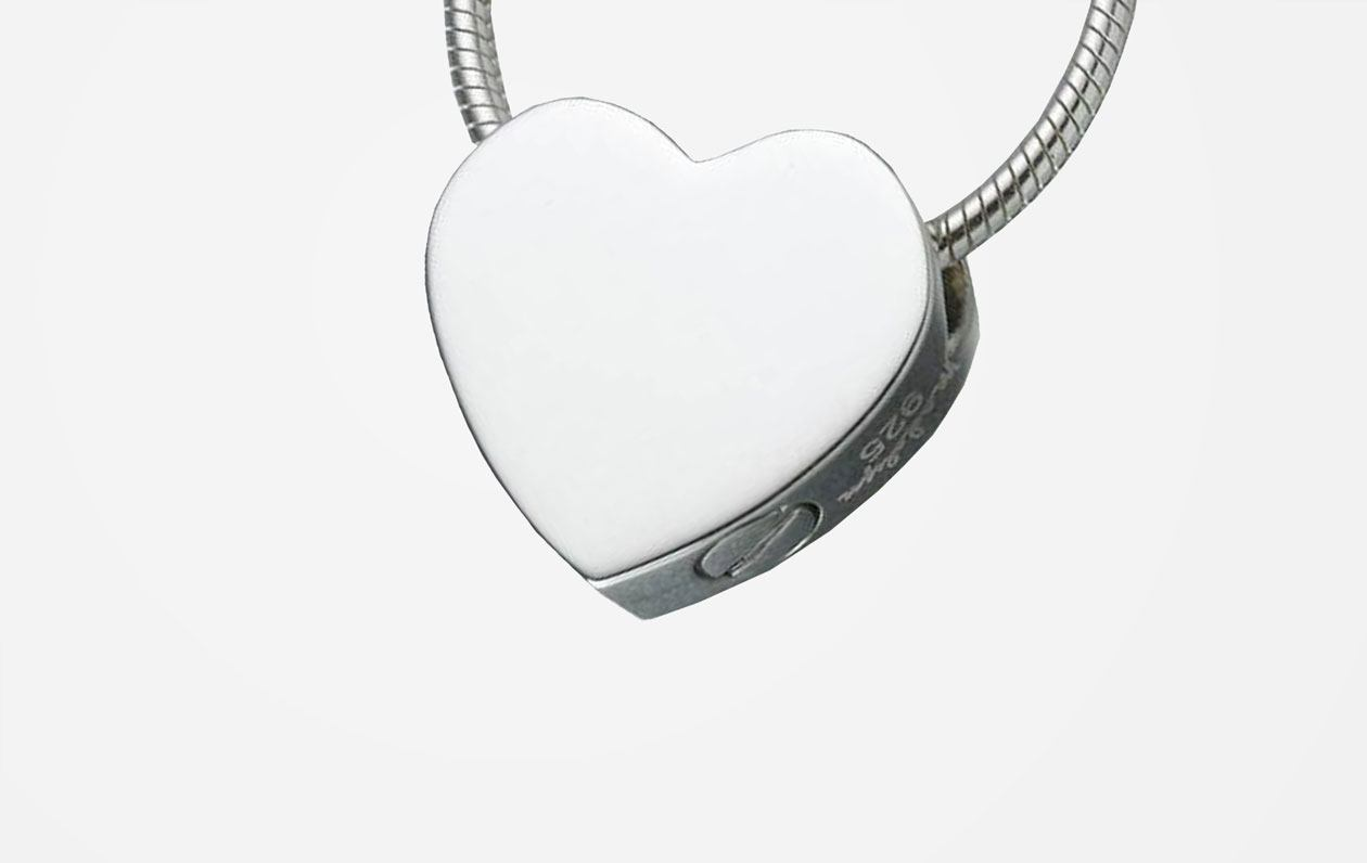 sterling-silver-double-chamber-heart-pendant